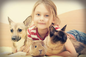 child and a cat and a dog and guinea pig in a retro style