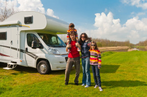 Family vacation, RV (camper) travel with kids, happy parents with children on holiday trip in motorhome ** Note: Visible grain at 100%, best at smaller sizes