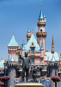 monument to walt disney and mickey mouse in disneyland california and cinderella castle